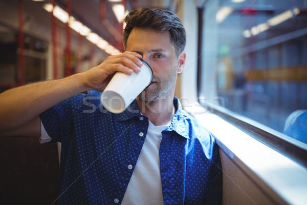 Jóképű férfi iszik kávé vonat szeretet férfi Stock fotó © wavebreak_media