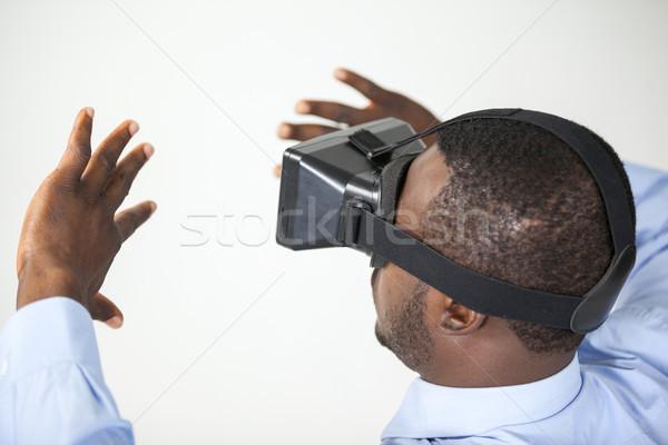 Férfi virtuális valóság headset fehér boldog Stock fotó © wavebreak_media