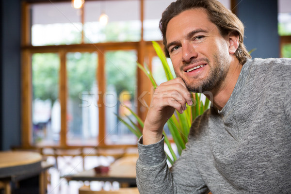 Confident young man in coffee shop Stock photo © wavebreak_media