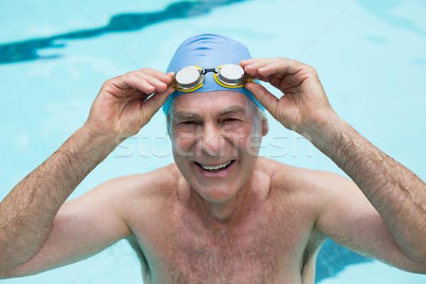 Kıdemli adam gözlük yüzme havuzu su Stok fotoğraf © wavebreak_media