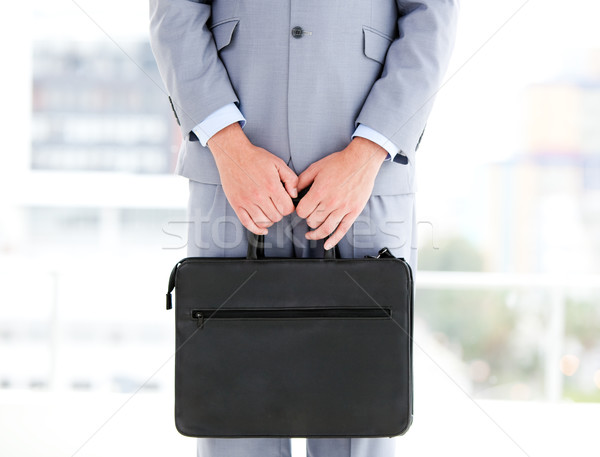 Mysterious businessman holding a briefcase Stock photo © wavebreak_media