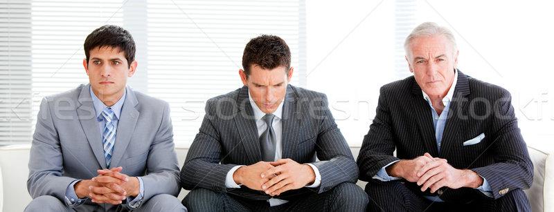 Trzy charyzmatyczny biznesmenów poczekalnia posiedzenia sofa Zdjęcia stock © wavebreak_media