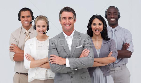 Multi-ethnic team working in a call center Stock photo © wavebreak_media
