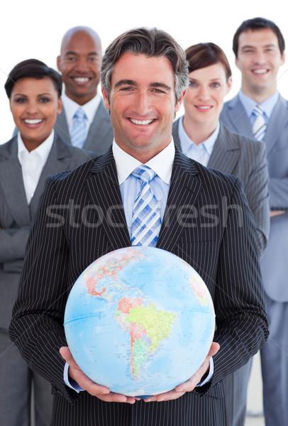 Ambiciózus üzleti csapat mutat földgömb fehér nő Stock fotó © wavebreak_media