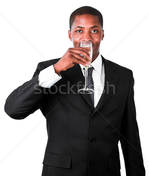 Friendly businessman drinking a glass of champagne Stock photo © wavebreak_media