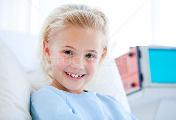 Sick little girl sitting on a hospital bed Stock photo © wavebreak_media