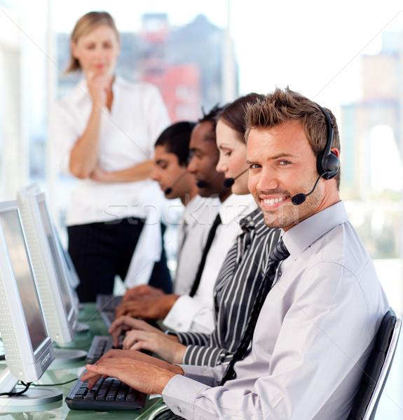 Happy female leader managingher team in a call center Stock photo © wavebreak_media