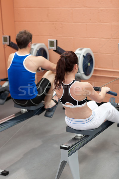 Sportsmen using a rower in a fitness center Stock photo © wavebreak_media