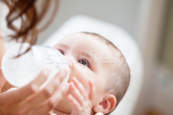 Positive mother feeding her adorable son in the kitchen at home Stock photo © wavebreak_media