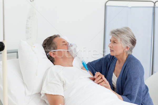 Old women taking care of her husband at home Stock photo © wavebreak_media