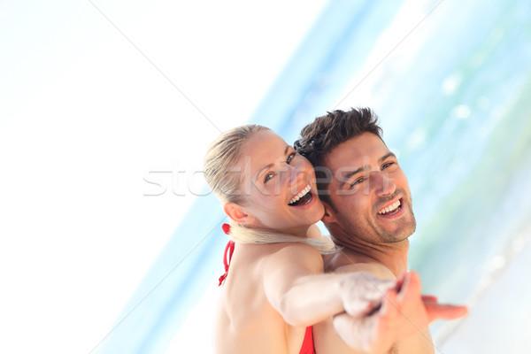 Belo homem namorada piggyback praia água Foto stock © wavebreak_media