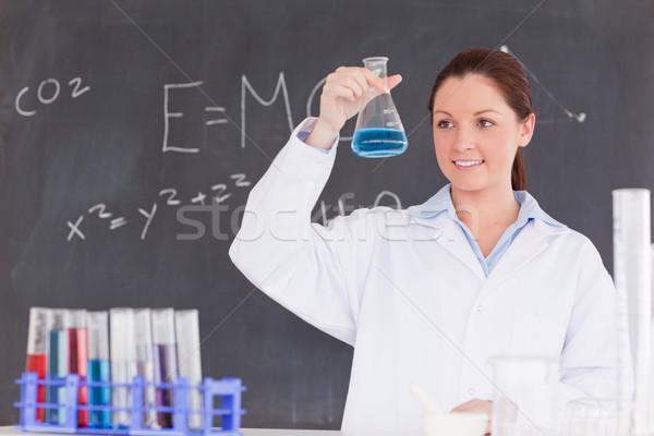 Cute wetenschapper naar container omhoog Blauw Stockfoto © wavebreak_media