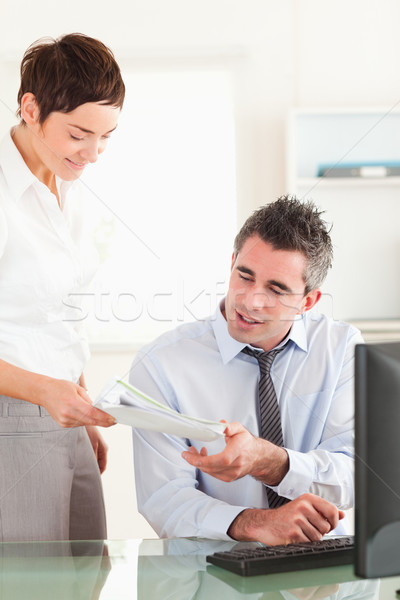 Stock photo: Portrait of a manager receiving a document from his employee in his office