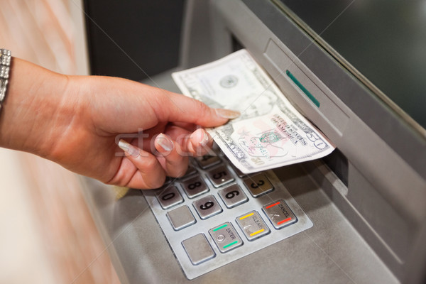 Feminine hand withdrawing dollars at an ATM Stock photo © wavebreak_media