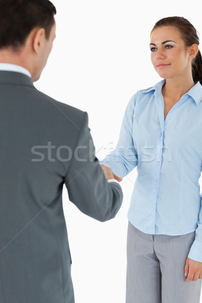 Young business partners agreeing on a deal against a white background Stock photo © wavebreak_media