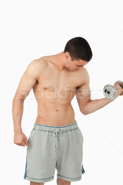Young male doing weight lifting against a white background Stock photo © wavebreak_media