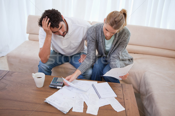Depressed couple doing their accounting in their living room Stock photo © wavebreak_media