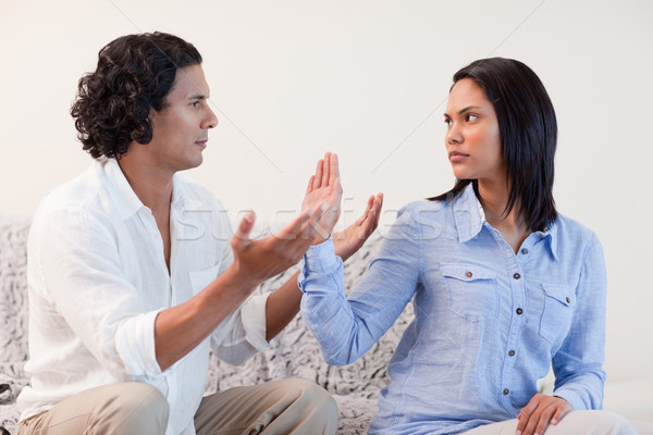 Young male begging his girlfriend for pardon Stock photo © wavebreak_media