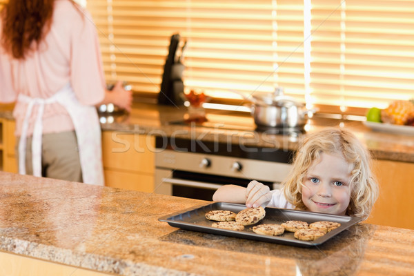 boy stealing a cookie while is mother is not watching Stock photo © wavebreak_media