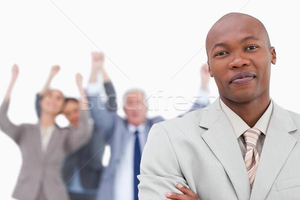 Handlowiec zespołu za biały uśmiech Zdjęcia stock © wavebreak_media