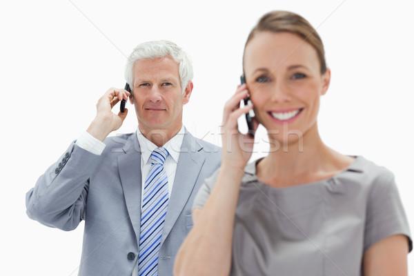 Primer plano pelo blanco empresario llamada mujer sonriente Foto stock © wavebreak_media