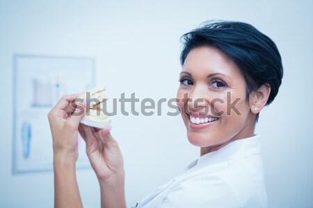 Close up of smiling female entrepreneur giving thumb up against a white background Stock photo © wavebreak_media