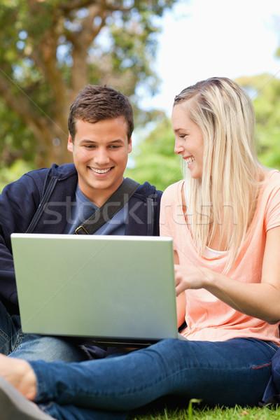 молодые люди смеясь сидят ноутбука парка Сток-фото © wavebreak_media
