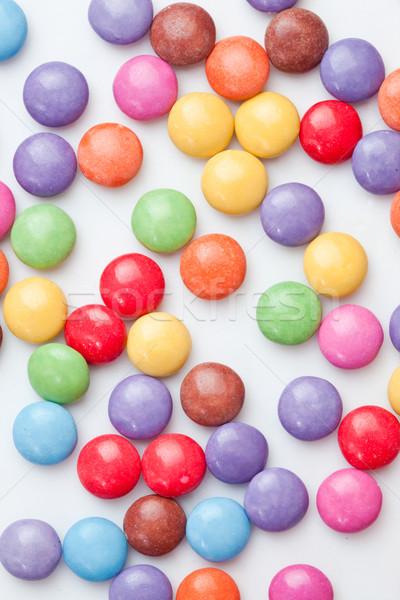 Chocolate candies multi coloured against a white background Stock photo © wavebreak_media