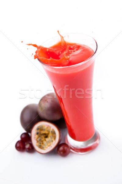 Overflowing glass of berries juice against white background Stock photo © wavebreak_media