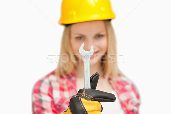 Woman presenting a wrench against white background Stock photo © wavebreak_media