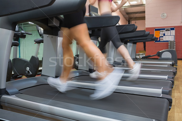 Two people running on treadmills in the gym side by side Stock photo © wavebreak_media