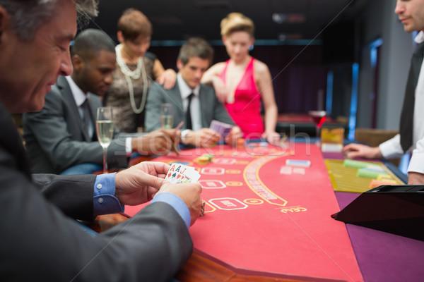 человека глядя счастливо покер стороны казино Сток-фото © wavebreak_media