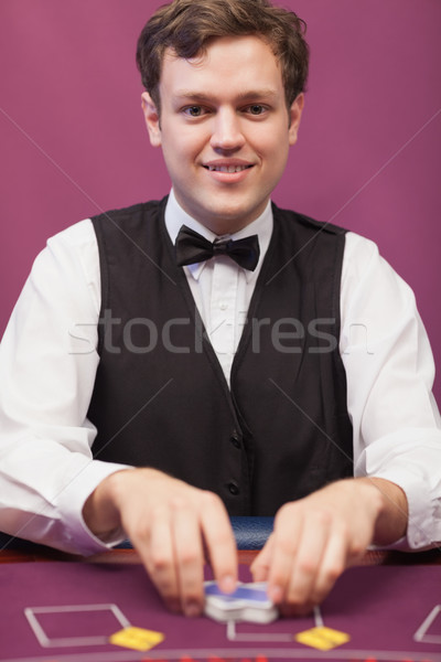 Dealer shuffling cards and smiling Stock photo © wavebreak_media