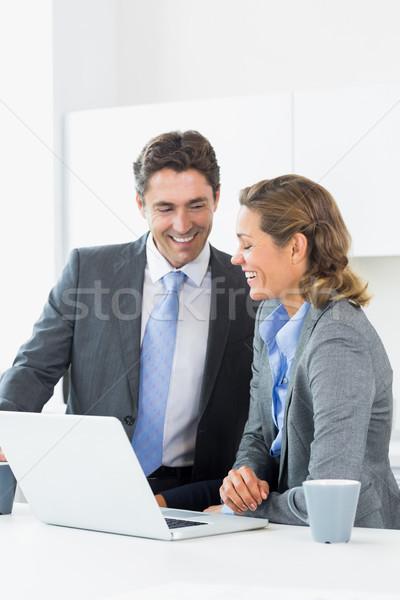 Smiling couple using laptop before work Stock photo © wavebreak_media