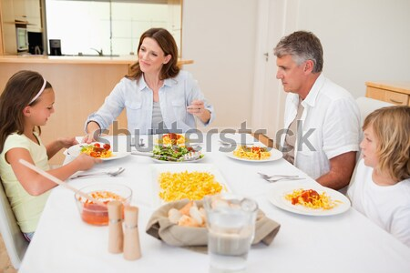 Family eating healthy dinner Stock photo © wavebreak_media