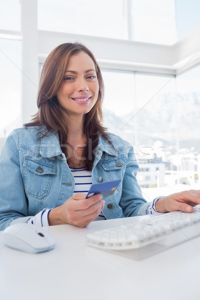Pretty woman purchasing online with her credit card Stock photo © wavebreak_media