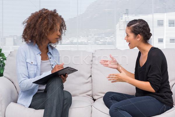 Upset woman speaking to her therapist Stock photo © wavebreak_media