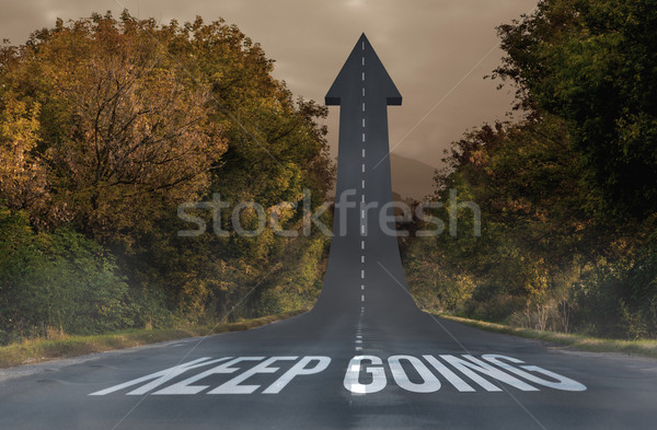 Keep going against road turning into arrow Stock photo © wavebreak_media