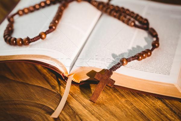 Open bible with rosary beads Stock photo © wavebreak_media
