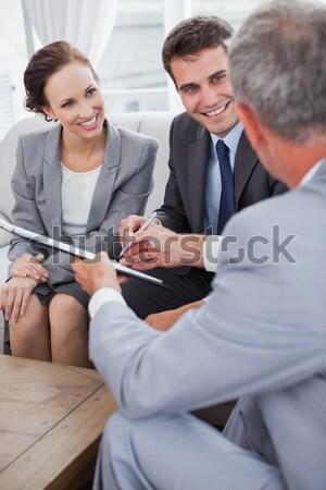 Souriant couple réunion financière conseiller Photo stock © wavebreak_media