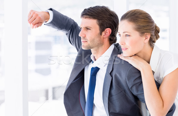 Smartly dressed business couple looking away in office Stock photo © wavebreak_media