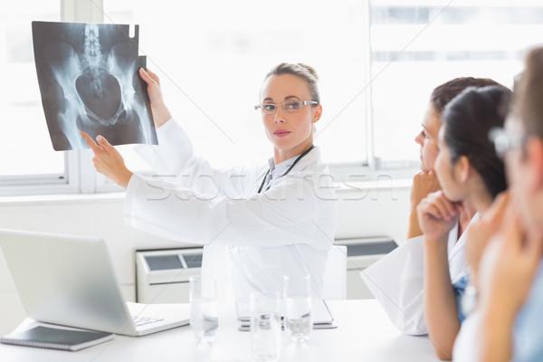 Confident doctor explaining Xray to colleagues Stock photo © wavebreak_media