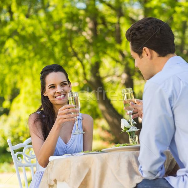 Paar champagne fluiten outdoor glimlachend Stockfoto © wavebreak_media