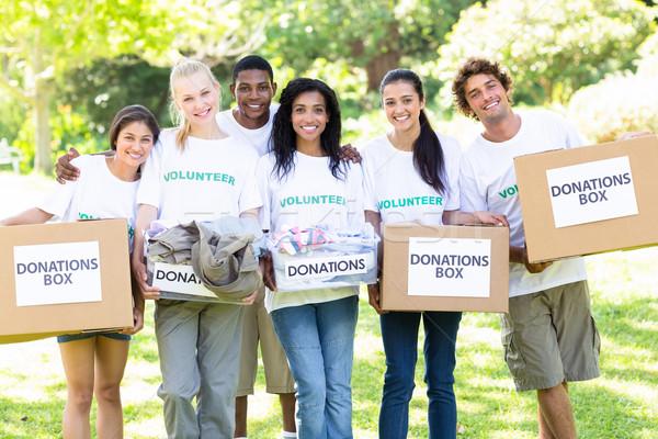 Volunteers carrying donation boxes Stock photo © wavebreak_media