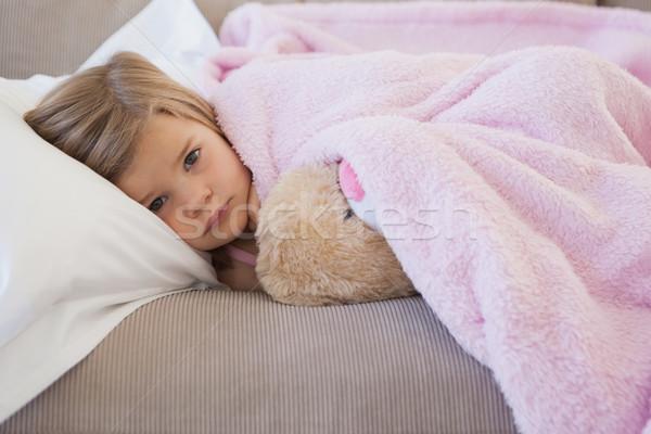 Genç kız kanepe doldurulmuş oyuncak portre Stok fotoğraf © wavebreak_media