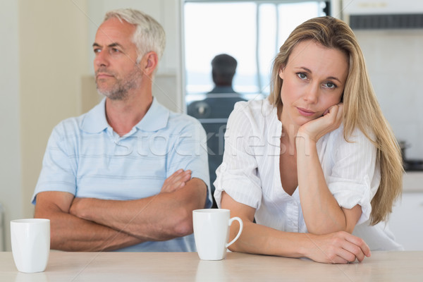 Fed up woman sitting at the counter with her partner Stock photo © wavebreak_media