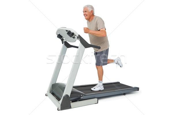 Teljes alakos idős férfi fut futópad fehér Stock fotó © wavebreak_media