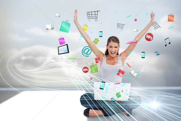Cheering blonde using laptop with app icons Stock photo © wavebreak_media