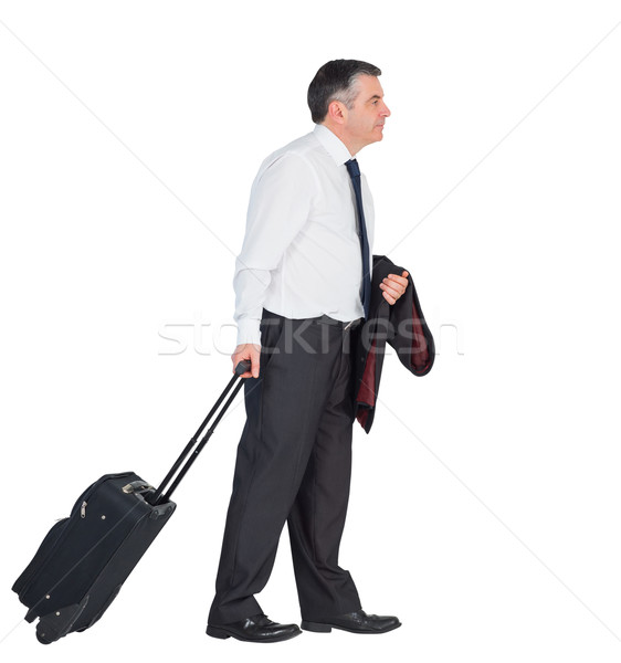 Mature businessman pulling his suitcase Stock photo © wavebreak_media