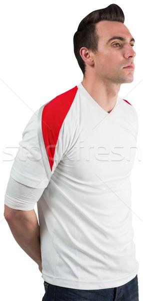 Handsome football fan looking ahead Stock photo © wavebreak_media